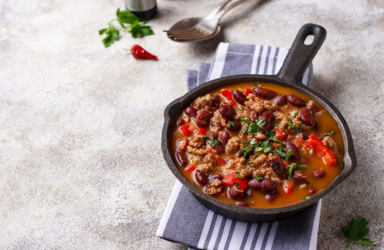 Traditional Mexican dish chili con carne in pan